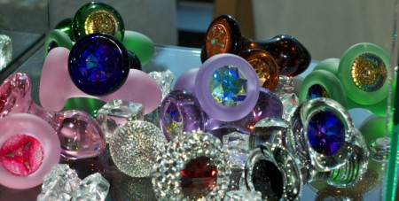 A pile of Crystal Delights glass butt plugs sparkling in the sun - taken in the vendor room at MomentumCon 2012