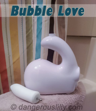 The Bubble Love and Dilly sitting on the edge of a bath tub