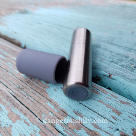 Crave Bullet Vibe Stainless Steel with Silicone Cap off to the side